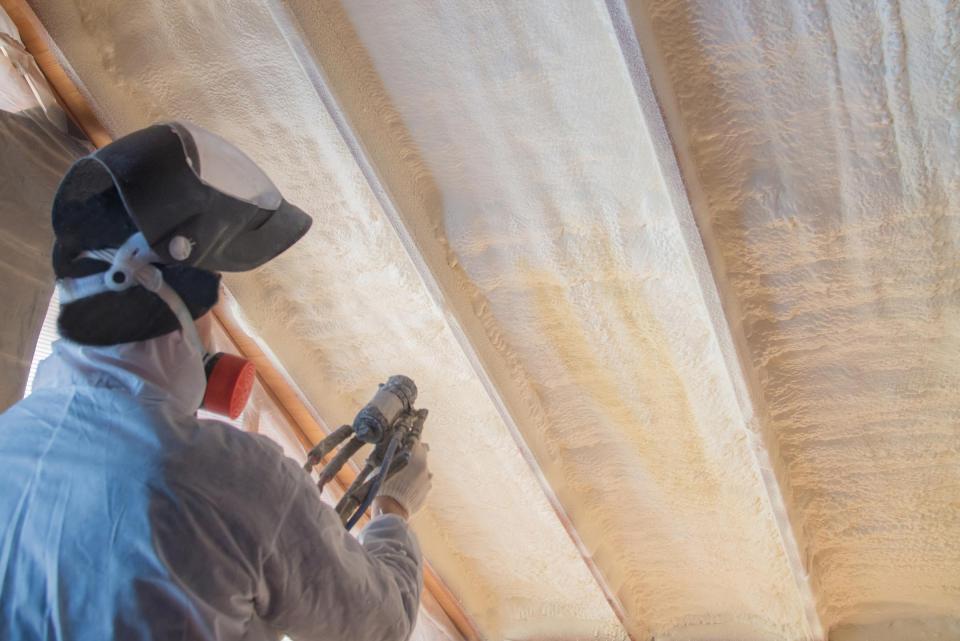 insulation contractor installs spray foam insulation