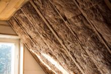 attic insulation featuring a skylight window