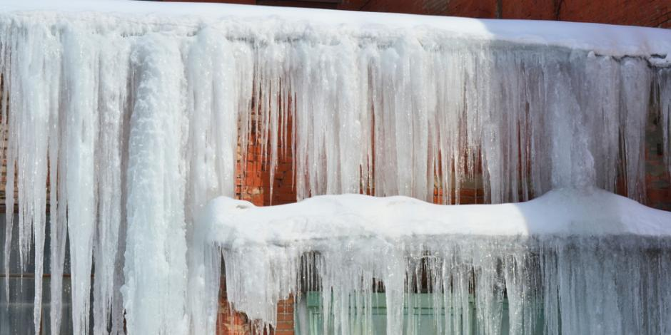 Long, big ice dams on a brick house roof